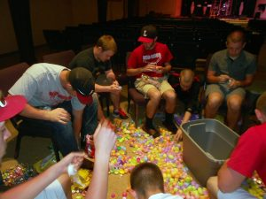 Baseball team fills Easter eggs